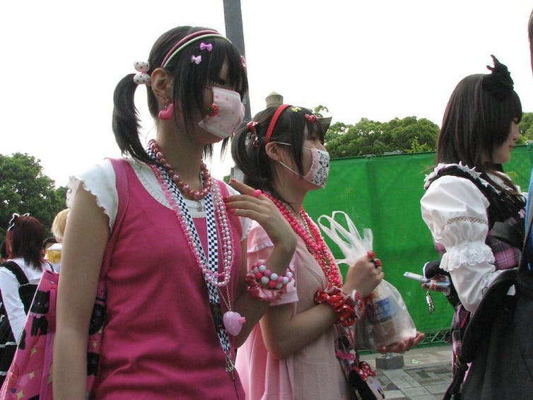 Two young women wearing face masks