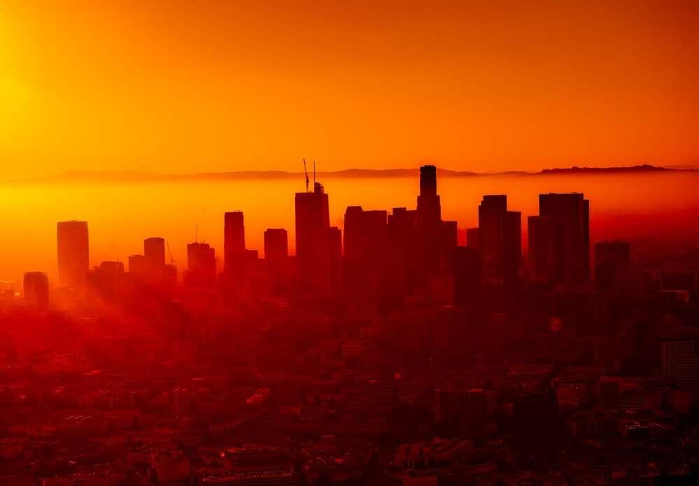 A city skyline against a sunset