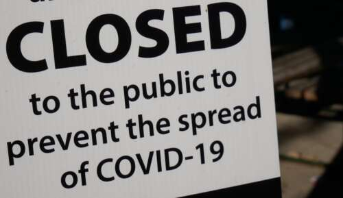 Sign says closed due to COVID-19