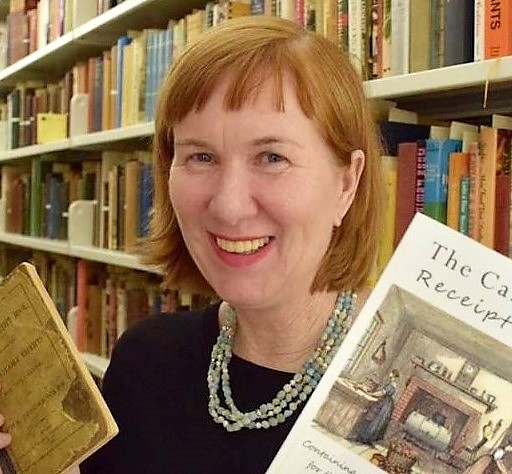 Melissa McAfee stands among the library stacks