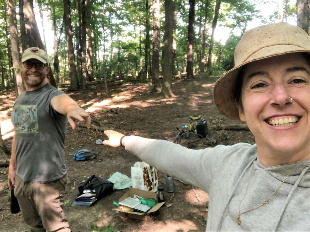 Profs. Alex Smith and Shoshanah Jacobs stand in a forest