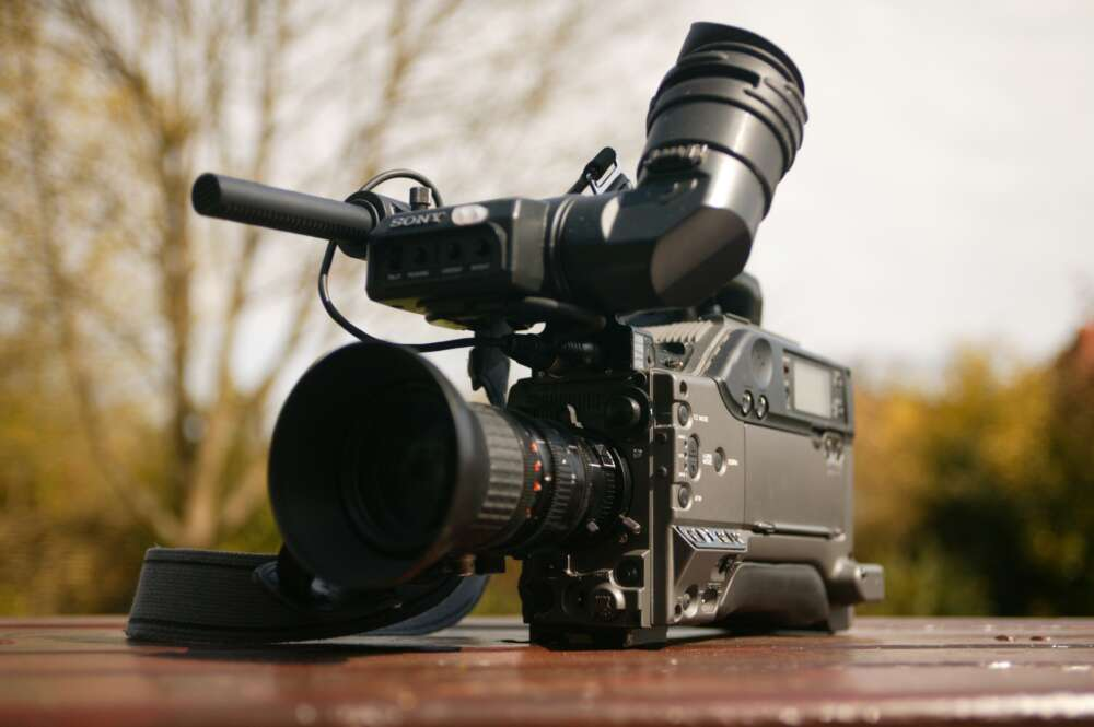 A television video camera sits on a table