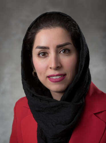 Woman in headscarf and red jacket