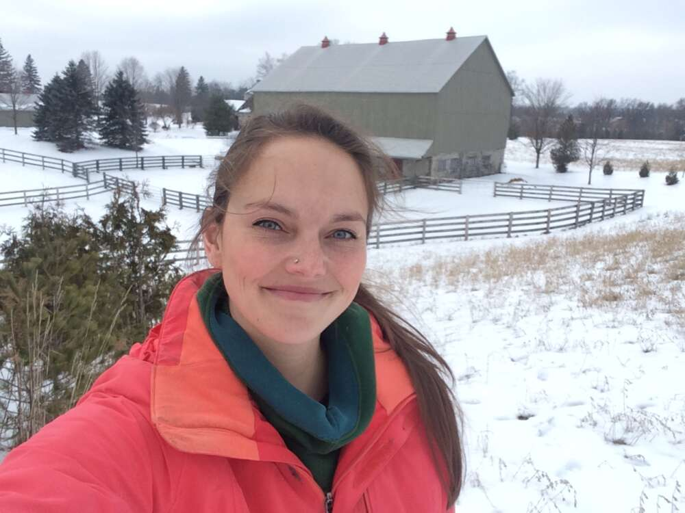 A photo of Dr. Meagan King with a barn in the background