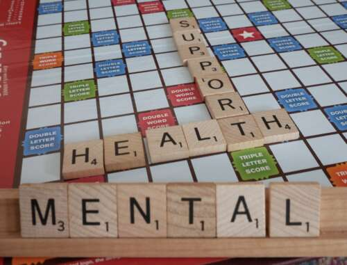 """Scrabble board with words """"Mental Health Support"""""""
