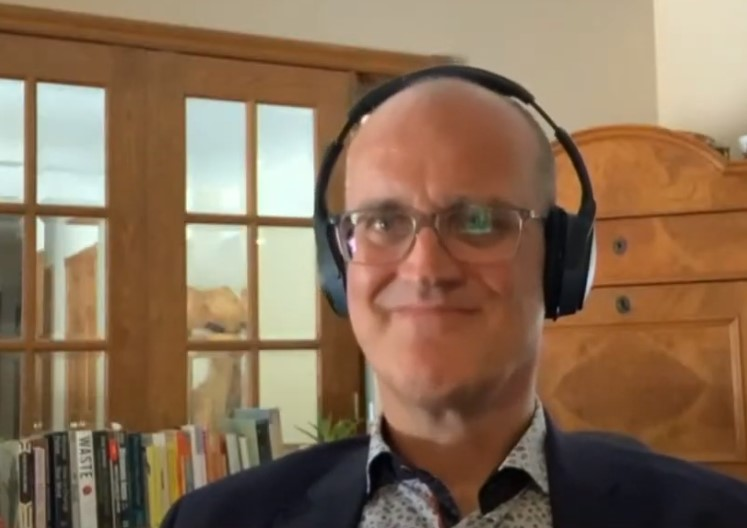 Dr. Mike Von Massow wears headphones while on a video call