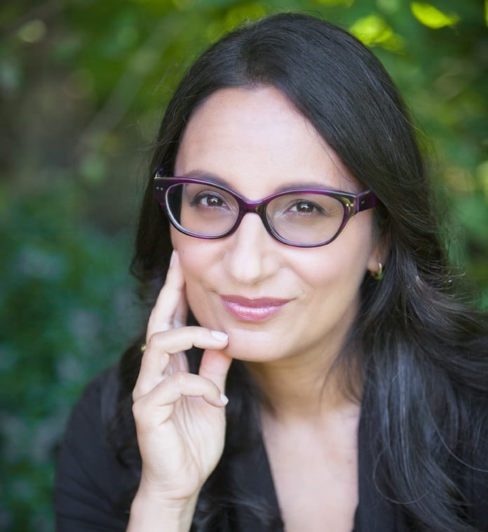 A headshot photo of Dr. Madhur Anand