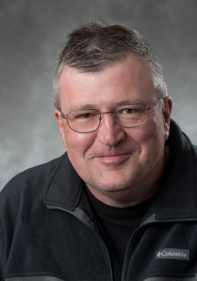 A headshot portrait of Dr. Ralf Gellert