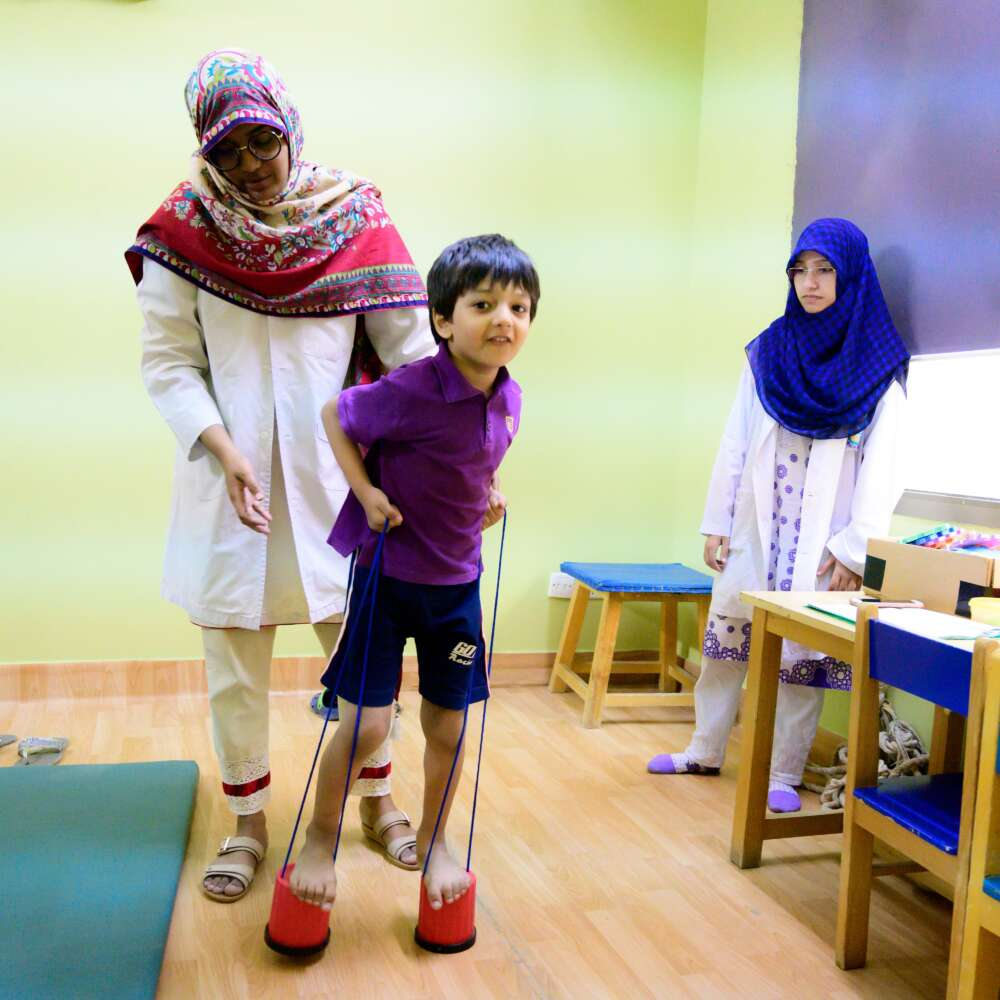 A child uses assistive devices to talk