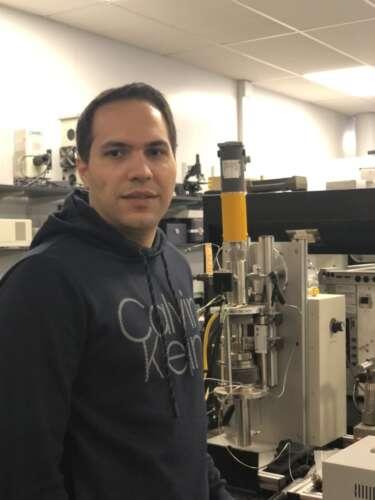 man standing in chemistry lab