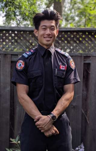 Young Asian man in firefighter shirt