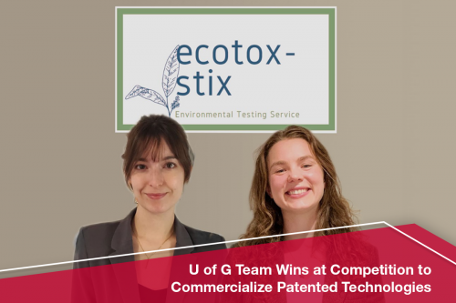 Rebecca Bradley and Brooke Rathie stand before a wall sign that reads Ecotox-Stix