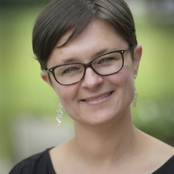 Woman with short hair and glasses
