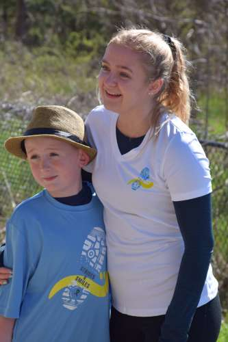 A young women and a boy, both cancer survivors