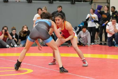 Two women wrestlers square off