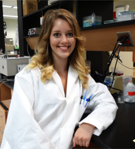 portrait of woman in lab smiling at camera