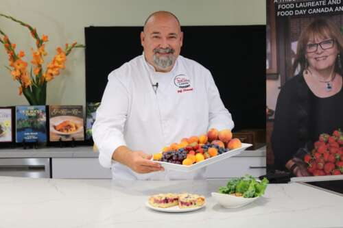 Chef displays tray of fruit