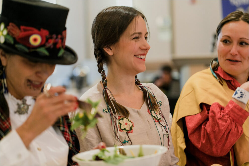 Three Indigenous women smiling broadly