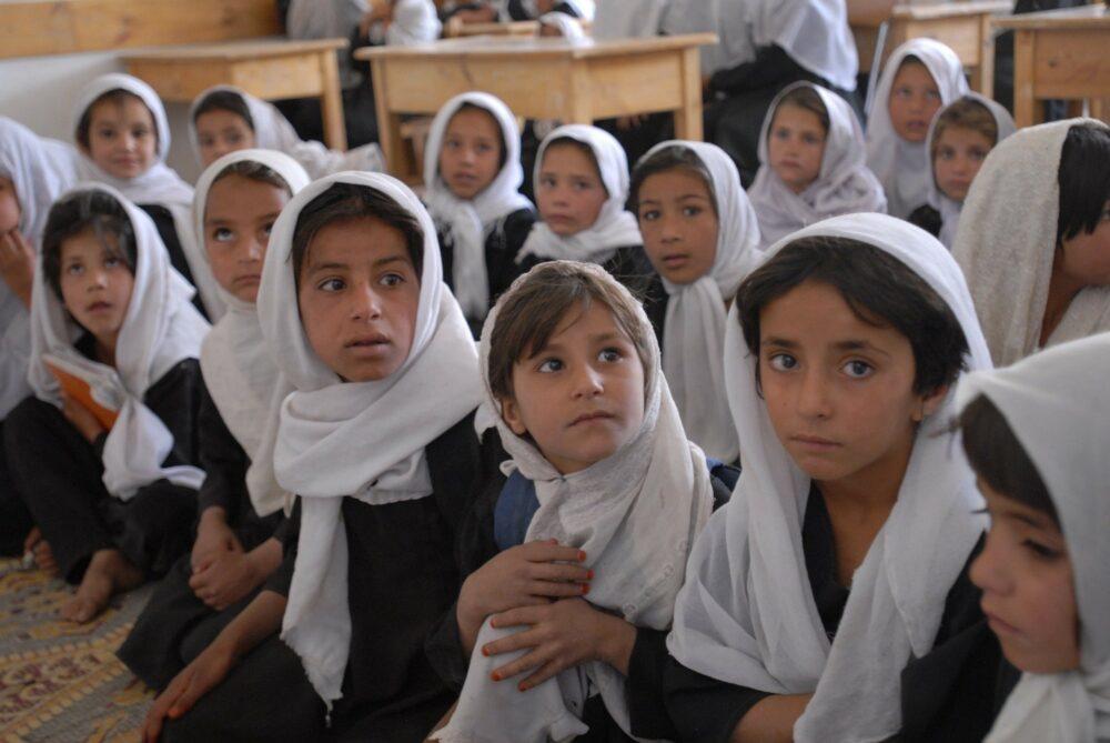 Afghan girls in head scarf attending school