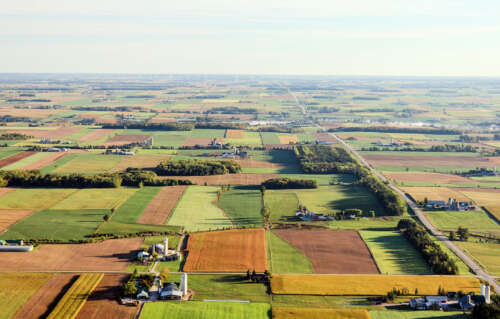A patchwork of fields is shown in this aerial view of the Waterloo Region