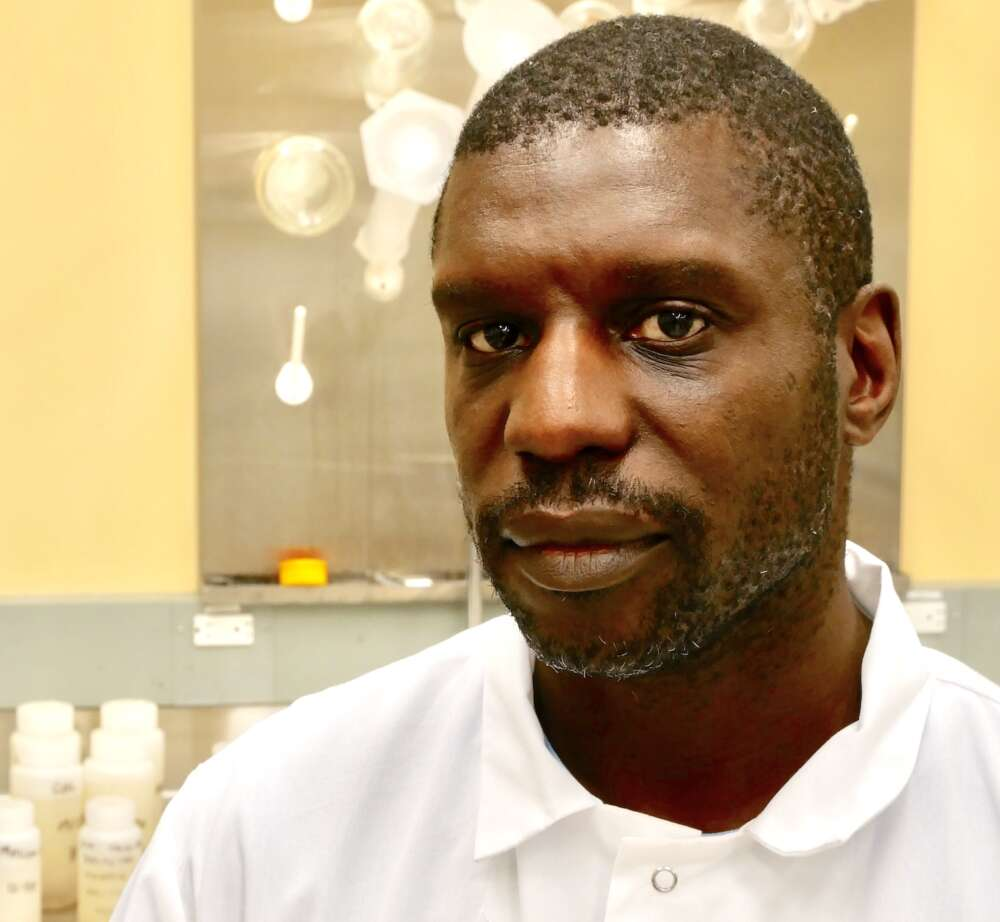 Black man, bearded, in laboratory setting