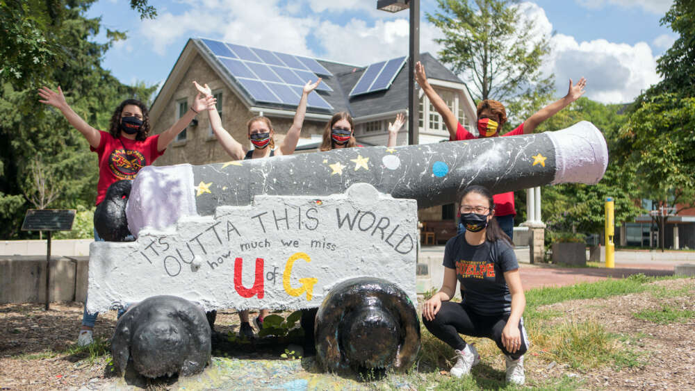 Five students wearing masks gather at the Cannon on the U of G campus