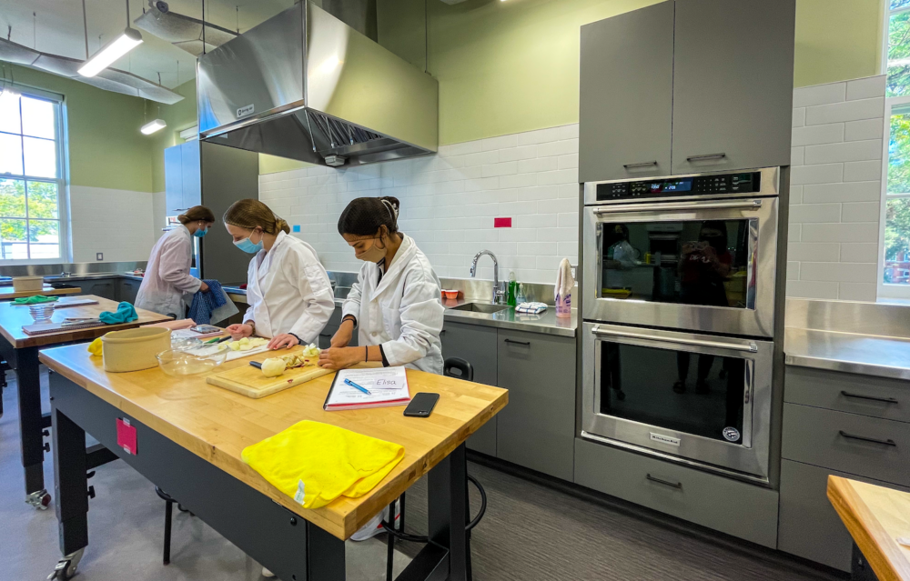 interior of food lab with 3 students