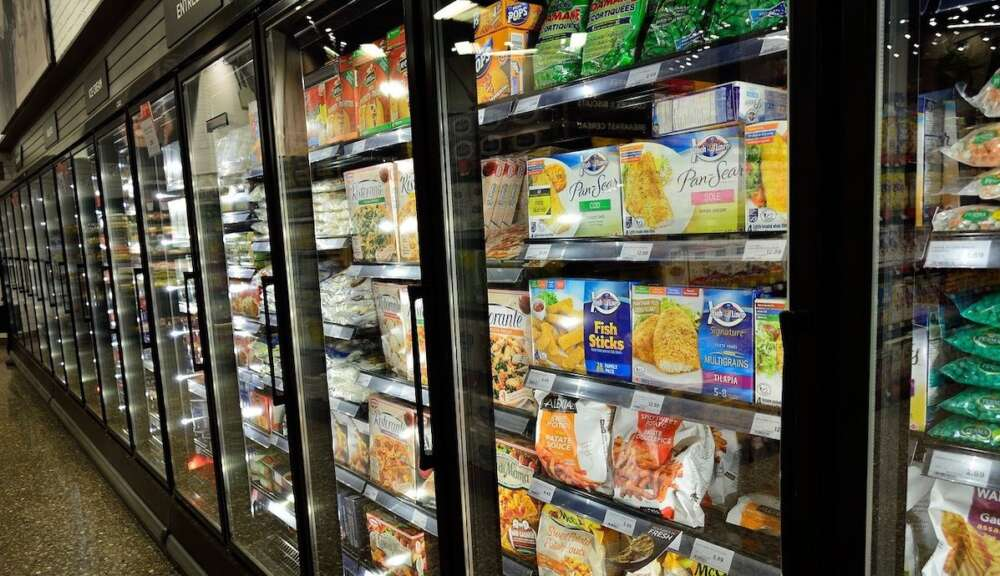 The frozen-food section of a grocery store is shown